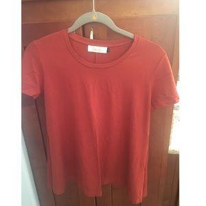 Cute dark orange blouse by Ava Sky.